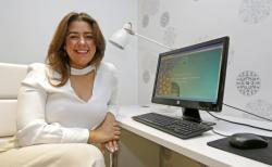 In this Tuesday, May 9, 2017, photo, small business owner Cristina Hermida poses for a photo, in Miami. Hermida, who owns two companies, Inside Crowd and Green Hopping, has interns who work for her remotely