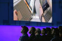 Audience members look on during a keynote address at the Microsoft Build 2017 developers conference, Thursday, May 11, 2017, in Seattle
