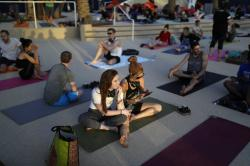 In this April 13, 2017, photo, Bri Ryan, left, and Summer Smith wait to take part in a yoga class by the pool at the Green Valley Ranch hotel and casino in Las Vegas