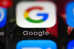This Wednesday, April 26, 2017, photo shows a Google icon on a mobile phone, in Philadelphia