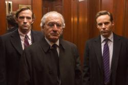 "This image released by HBO shows Nathan Darrow as Andrew Madoff, left, Robert De Niro as Bernie Madoff, center, and Alessandro Nivola as Mark Madoff in ""The Wizard of Lies,"" premiering Saturday at 8 p.m. ET on HBO"