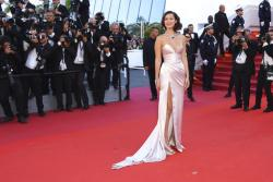Bella Hadid poses for photographers upon arrival at the opening ceremony and the screening of the film Ismael's Ghosts at the 70th international film festival, Cannes.