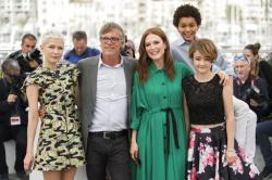 Actress Michelle Williams, from left, director Todd Haynes, actors Julianne Moore, Jaden Michael and Millicent Simmonds pose for photographers during the photo call for the film Wonderstruck at the 70th international film festival, Cannes.