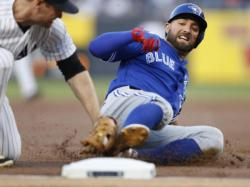 Toronto Blue Jays centre fielder Kevin Pillar slides into third base against the New York Yankees.