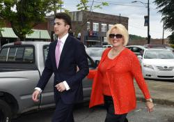 Brooke Covington, a member of the Word of Faith Fellowship church in Spindle, N.C., leaves a hearing at Rutherford County Courthouse accompanied by attorney, Joshua Valentine, in Rutherfordton, N.C.