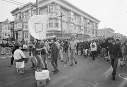 In this April 3, 1967 file photo, people parade up and down the streets of the Haight-Ashbury district in San Francisco