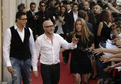 "Fashion designers Stefano Gabbana, left, and Domenico Dolce arrive for the presentation of the book ""Milan Fashion, soccer players portraits"", in downtown Milan, Italy."