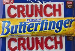 In this Wednesday, June 1, 2016, file photo, a Nestle Butterfinger and Crunch candy bars are arranged for a photo, in New York