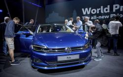 Visitors take a look at the new VW Polo during the world premiere in Berlin, Germany, Friday, June 16, 2017