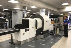In this Wednesday, June 14, 2017, photo provided by American Airlines, a Transportation Security Administration officer operates an L3 ClearScan baggage screener, featuring 3-D scanning technology, at a checkpoint at Phoenix Sky Harbor International Airport, in Phoenix