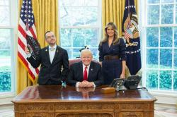 Nikos Giannopoulos (left) with President Donald Trump (center) and First Lady Melania Trump (right)