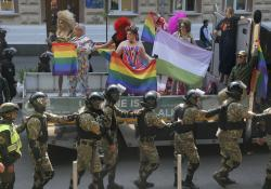 Ukrainian police guard the participants of the annual Gay Pride parade in Ukraine's capital Kiev.