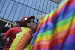 Parcicipants kiss as they march during the annual Gay Pride Parade in Sao Paulo, Brazil.