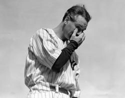 In this July 4, 1939, file photo, New York Yankees' Lou Gehrig wipes away a tear while speaking during a tribute at Yankee Stadium in New York