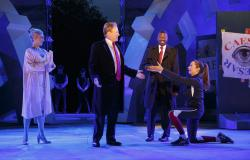 In this May 21, 2017, file photo provided by The Public Theater, Tina Benko, left, portrays Melania Trump in the role of Caesar's wife, Calpurnia, and Gregg Henry, center left, portrays President Donald Trump in the role of Julius Caesar during a dress rehearsal of The Public Theater's Free Shakespeare in the Park production of Julius Caesar in New York