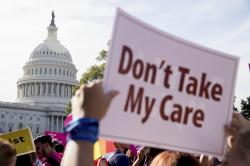 A large group of protesters rally against the Senate Republican healthcare bill on the East Front of the Capitol Building in Washington, Wednesday, June 28, 2017