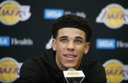 In this June 23, 2017, file photo, Los Angeles Lakers draft pick Lonzo Ball speaks during a news conference in El Segundo, Calif.