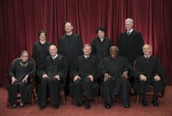 In this June 1, 2017, file photo, the justices of the U.S. Supreme Court gather for an official group portrait to include new Associate Justice Neil Gorsuch, top row, far right at the Supreme Court Building in Washington