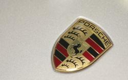 In this March 15, 2013 file photo the company logo of German car manufacturer Porsche is pictured prior to the annual news conference in Stuttgart, Germany