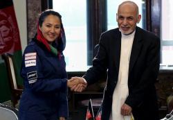 Afghan President Ashraf Ghani shakes hands with Afghan-American female pilot Shaesta Waiz
