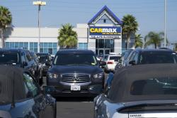 "This June 28, 2017, photo provided by Edmunds shows the lot of a CarMax used-car ""superstore,"" in Inglewood, Calif."