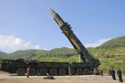 In this July 4, 2017, file photo distributed by the North Korean government, North Korean leader Kim Jong Un, second from right, inspects the preparation of the launch of a Hwasong-14 intercontinental ballistic missile (ICBM) in North Korea's northwest