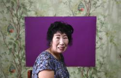 In this July 11, 2017 photo, South Korea's YouTube star, Park Makrye, 70, poses for a photo in front of a stage for her YouTube channel during an interview at her home in Yongin, South Korea