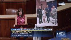 Rep. Martha McSally, R-Ariz., wearing a sleeveless dress while speaking on the floor of the House on Capitol Hill in Washington.