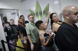 People wait in line at the Essence cannabis dispensary, Saturday, July 1, 2017, in Las Vegas