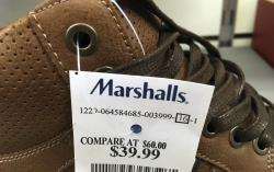 This Tuesday, May 16, 2017, photo shows a price tag on a pair of shoes for sale at a Marshalls store, in Methuen, Mass.