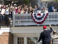 President Donald Trump turns to the clubhouse crowd as he arrives to enter his presidential viewing stand, Sunday, July 16, 2017, during the U.S. Women's Open Golf tournament at Trump National Golf Club in Bedminster, N.J