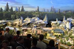 """Members of the media get their first look at a 50-foot, detailed model of """"Star Wars"""" land during a media preview for Disney's D23 Expo in Anaheim, Calf., on Thursday, July 13, 2017"""