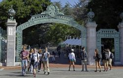 In this April 21, 2017, file photo, students walk past Sather Gate on the University of California, Berkeley campus in Berkeley, Calif.