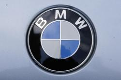 The brand logo of German car maker BMW is photographed on a car in Berlin, Tuesday, Aug. 1, 2017