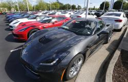 In this Wednesday, April 26, 2017, photo, Chevrolet Corvettes and other vehicles line the lot at a Chevrolet dealership in Richmond, Va.