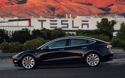 This file image provided by Tesla Motors shows the Tesla Model 3 sedan. Tesla is raising $1.5 billion as it ramps up production of its Model 3 sedan, its first mass market electric car, the company said Monday, Aug. 7, 2017