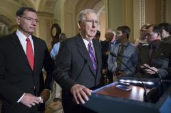 In this Aug. 1, 2017, photo, Senate Majority Leader Mitch McConnell, R-Ky., joined at left by Sen. John Barrasso, R-Wyo., holds his first news conference since the Republican health care bill collapsed last week due to opposition within the GOP ranks, on Capitol Hill, in Washington