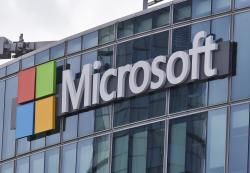 This April 12, 2016, file photo shows the Microsoft logo in Issy-les-Moulineaux, outside Paris, France.