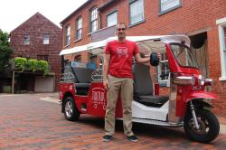 In this Aug. 8, 2017 photo, Timm Wenger poses with his tuk-tuk in Lancaster, Pa.