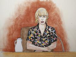 In this courtroom sketch, pop singer Taylor Swift speaks from the witness stand during a trial Thursday, Aug. 10, 2017, in Denver