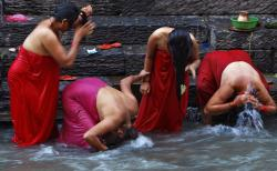 Nepalese Hindu women bathe in the Bagmati River on Rishi Panchami