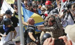 White nationalist demonstrators clash with counter demonstrators at the entrance to Lee Park in Charlottesville, Va.,