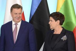 Polish Prime Minister Beata Szydlo, right, and her counterpart from Latvia Maris Kucinskis, left ,on their way for talks in Warsaw, Poland, Tuesday, Sept. 5, 2017