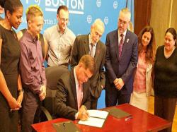 On Thursday, August 31, 2017 Boston Mayor Martin J. Walsh, seated, signed the Paris Declaration