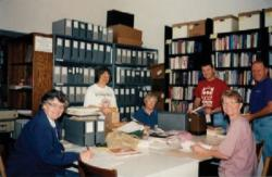 Archives photo from about 2000 of volunteers sorting documents: (l to r) Jeri Dilno, an unidentified woman, Lea Goyne, Dennis Fiodaliso, Sharon Parker and Dennis Howard