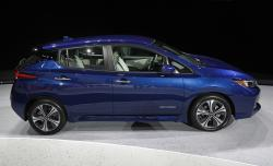 The 2018 Nissan Leaf is on display during an unveiling event, Tuesday, Sept. 5, 2017, in Las Vegas. Japanese automaker Nissan Motor Co. unveiled its zero-emissions vehicle in the U.S. late Tuesday