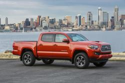 This photo provided by Toyota shows the 2017 Toyota Tacoma, an example of a truck that could be less expensive to lease than to buy.