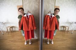 Aeroflot flight attendant Yevgeniya Magurina shows her uniform during an interview with the Associated Press.