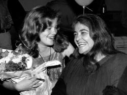 Feminist activist Kate Millett, right, laughs, during a surprise birthday party for her niece, Kristan Vigard, in New York.
