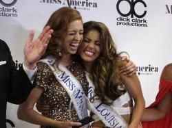 Miss Minnesota Brianna Drevlow, left, and Miss Louisiana Laryssa Bonacquisti, right, meet reporters after winning preliminary competitions.
